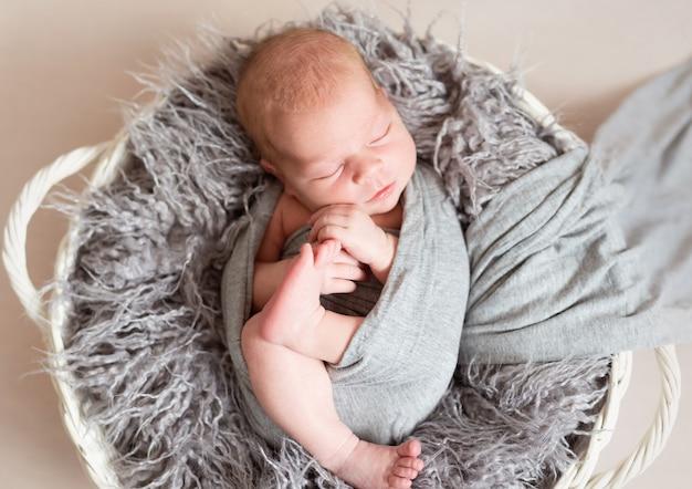 Newborn kid in nest bed