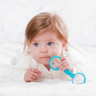 Newborn posing with toy