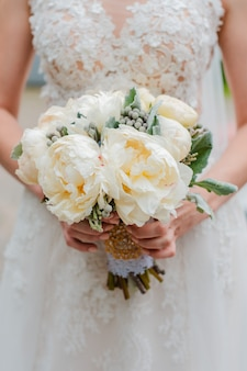 Newly married couple. wedding day. bouquet of the bride in the hands, the groom's embrace.