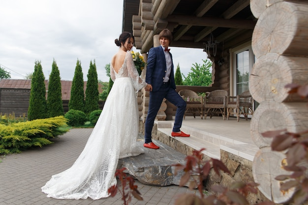Newly married ready to enter in luxurious wooden mansion