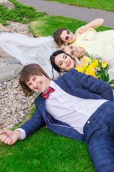 Newly married with bridesmaids having fun on wedding ceremony