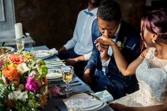 Newlywed African Descent Couple Kissing Hands