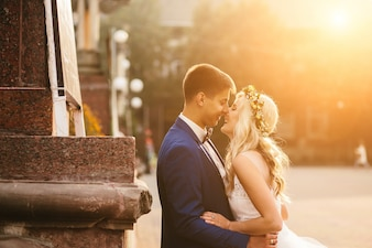 Newlywed couple kissing in street