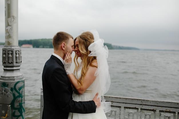 Newlywed couple on waterfront