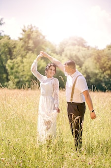 Newlywed dancing in the meadow