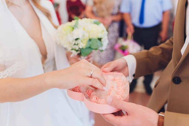 Newlyweds append signatures in a registry office during wedding registration.