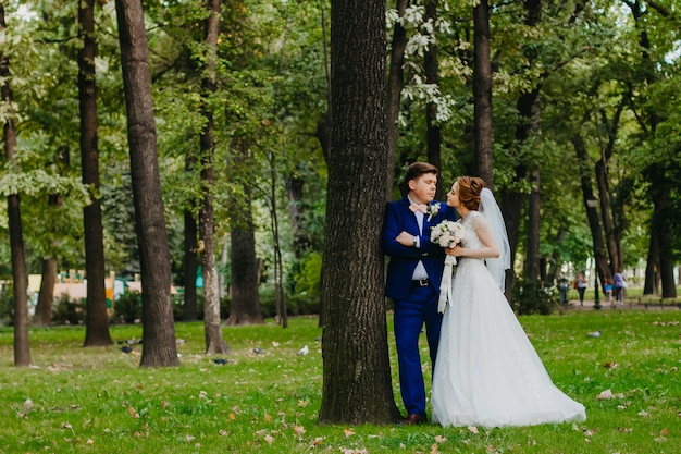 Newlyweds are walking in the park