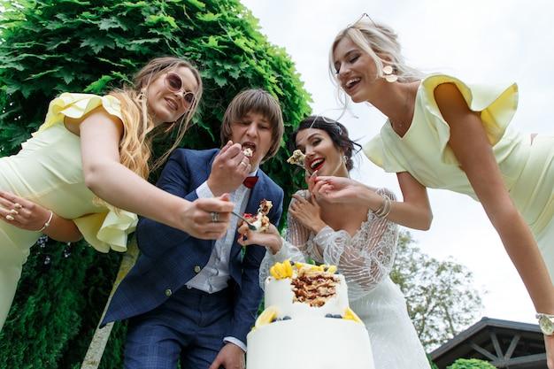 Newlyweds and bridesmaids have fun
