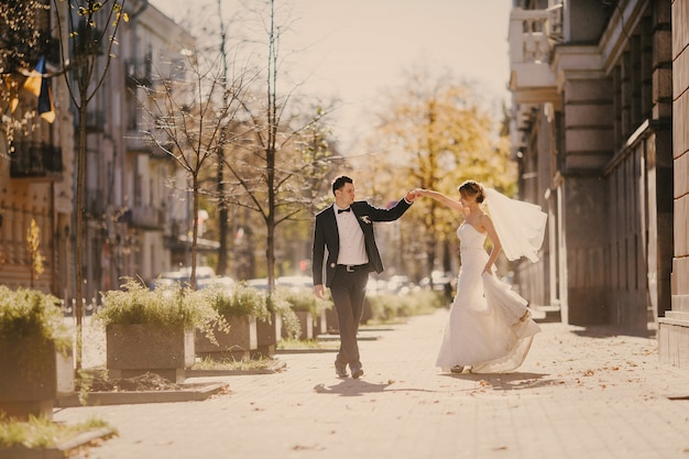 Newlyweds dancing on the street