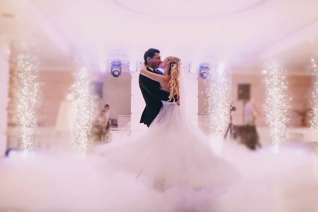 Newlyweds dancing together