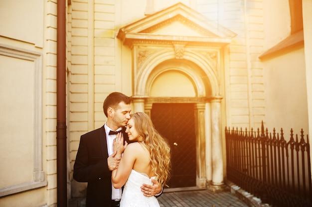 Newlyweds embraced on a sunny day