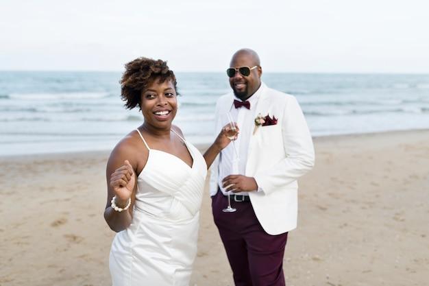Newlyweds enjoying their wedding reception on the beach