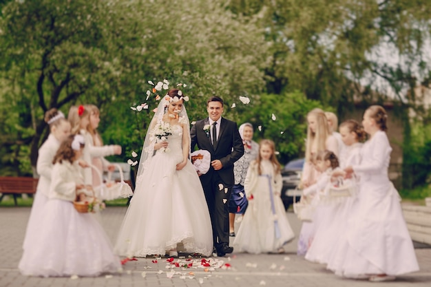 Newlyweds and girls throw their petals