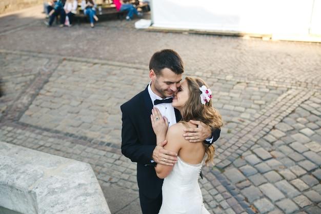 Newlyweds hugging and kissing