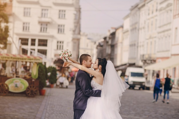 Newlyweds hugging with blurred background