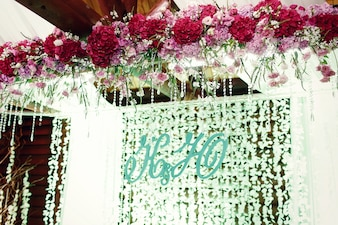 Newlyweds' initials stand hang before the light garlands