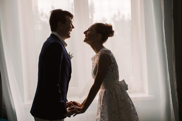 Newlyweds laugh indoor