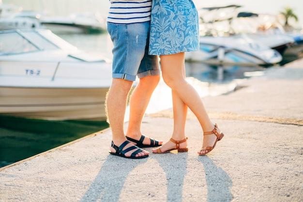 Newlyweds on the quay legs closeup