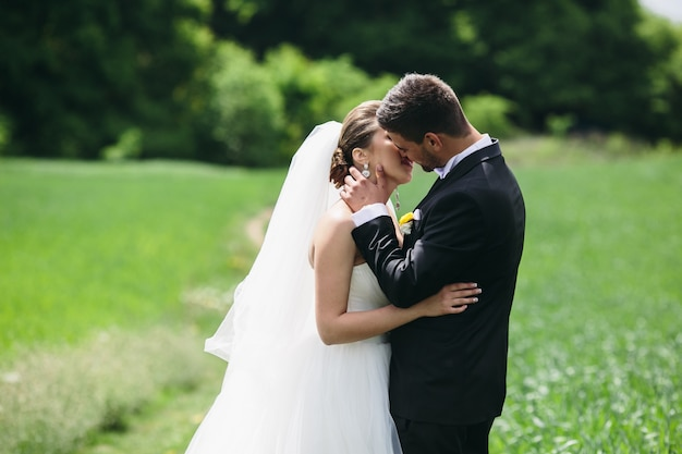Newlyweds sharing a romantic kiss