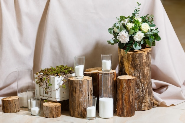 Newlyweds table setting decorated in rustic style nature theme in decoration