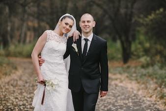 Newlyweds walking in the field