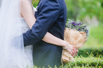 Newlyweds with a bouquet of beautiful flowers