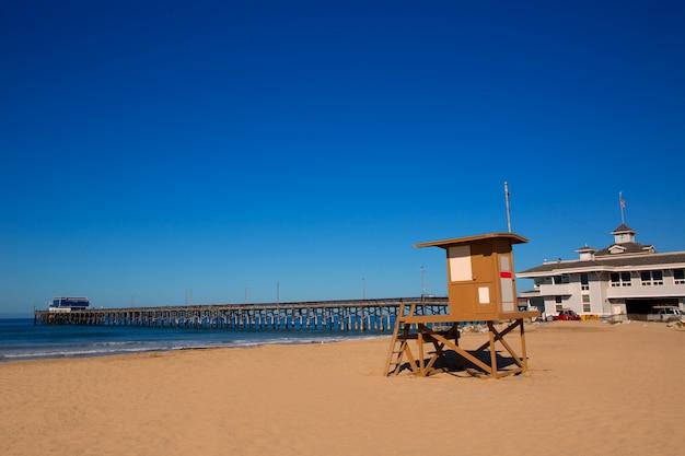 Newport pier beach with lifeguard tower in california