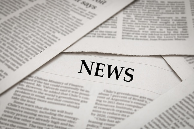News headline on newspaper background