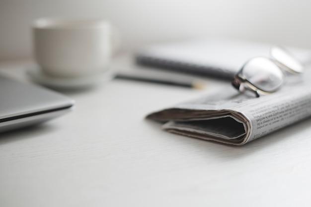 News press on a business desk.