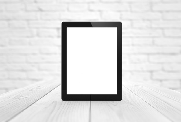 News tablet with blank screen on wooden table