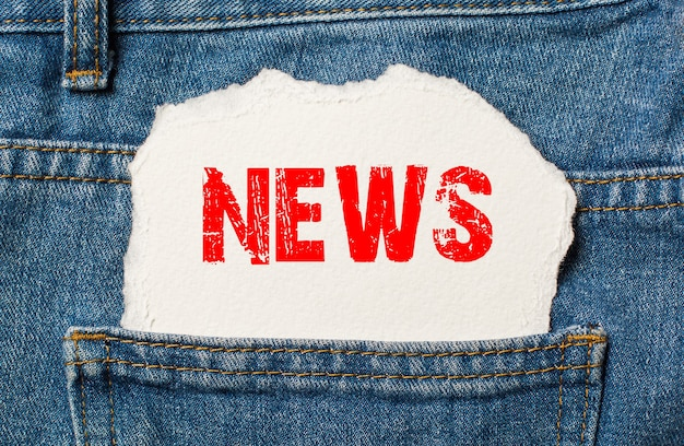 News on white paper in the pocket of blue denim jeans