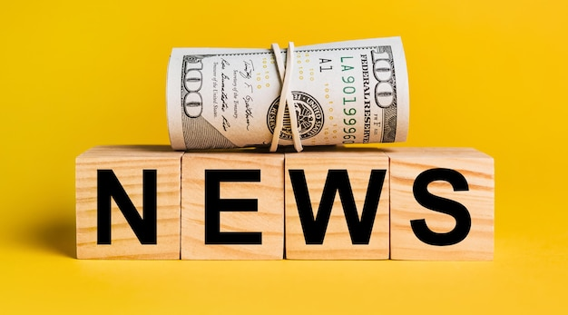 News with money on a yellow background. the concept of business, finance, credit, income, savings, investments, exchange, tax