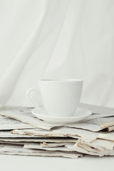 Newspapers and coffee cup