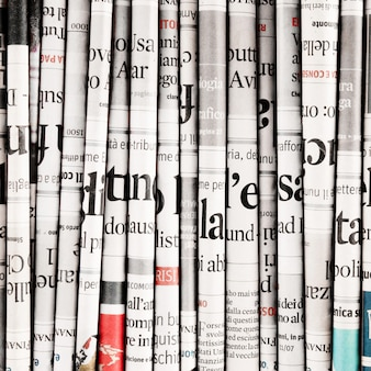 Newspapers folded to form a background