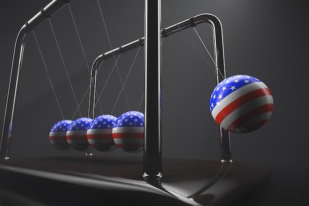 動作中のニュートンのゆりかご。米国の記号が付いた風船。政治的な話題。
