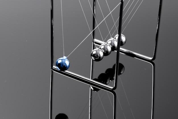 Newtons cradle balancing balls, business concept in studio
