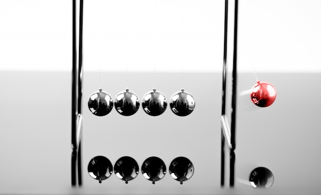 Newtons cradle balancing balls, business concept