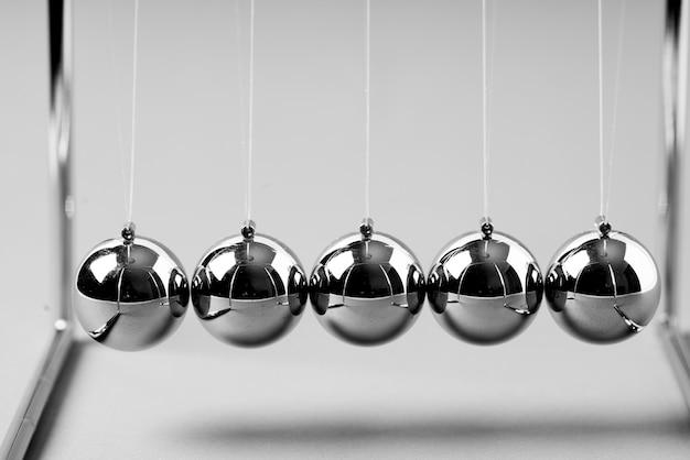 Newtons cradle balancing balls, business