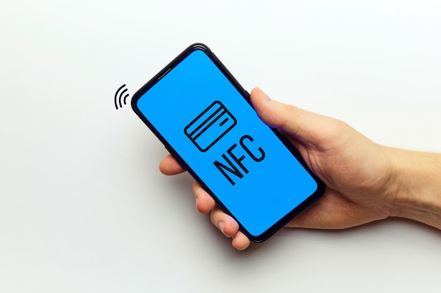 Nfs wireless technology payment concept with smartphone in person hand.