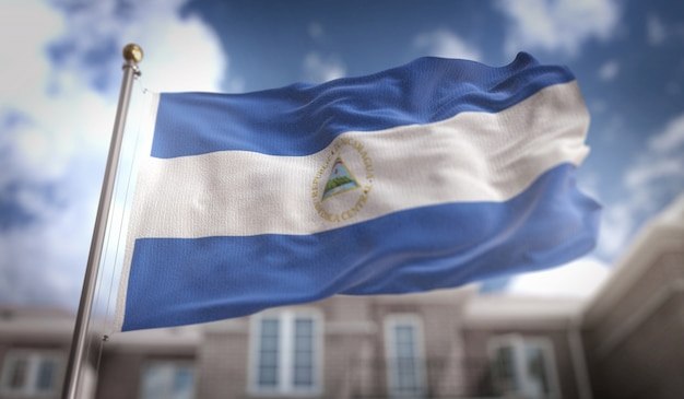 Nicaragua flag 3d rendering on blue sky building background