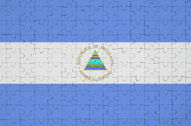 니카라과 국기는 접힌 퍼즐에 그려져 있습니다