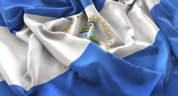 Nicaragua flag ruffled beautifully waving macro close-up shot