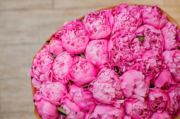 Nice big bouquet of a lot of peonies of rosy color