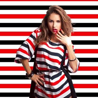 Nice brown hair girl on stripes background in studio