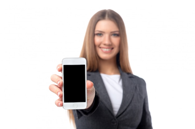 Nice businesswoman showing black smartphone screen isolated on white