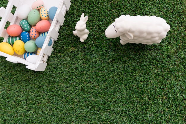 Nice composition with sheep, rabbit and easter eggs