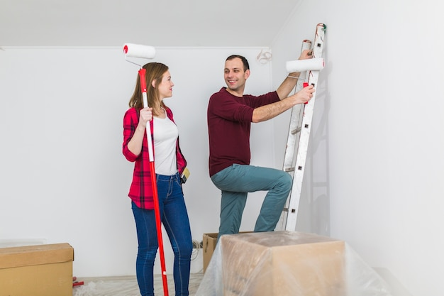 Nice couple painting walls