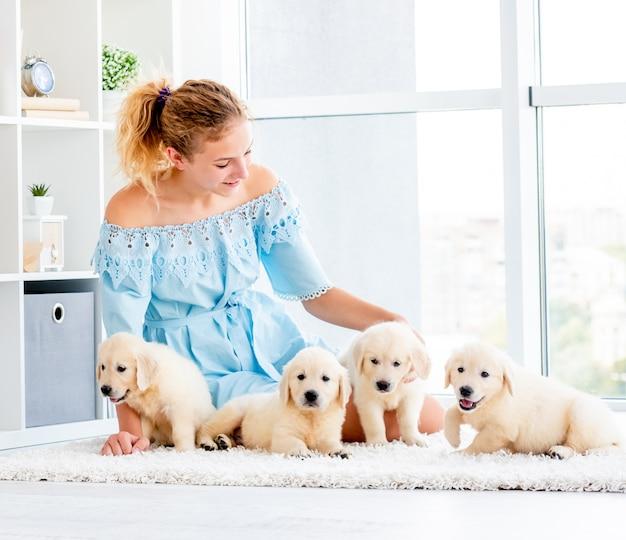 Nice girl and retriever puppies