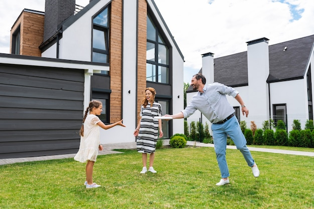 Nice happy man throwing the plate while playing with his family