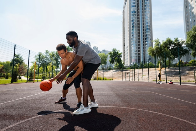Nice men training on the basketball court